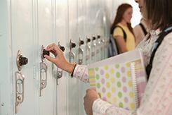 Bullied girl at locker
