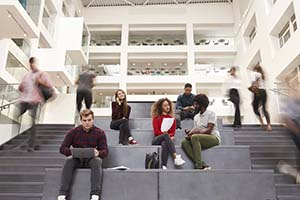 Image of college students sitting on steps