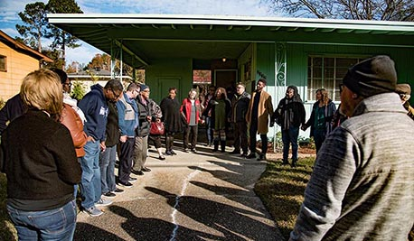 Image of group of AIR staff in front of Medgar Evers' home