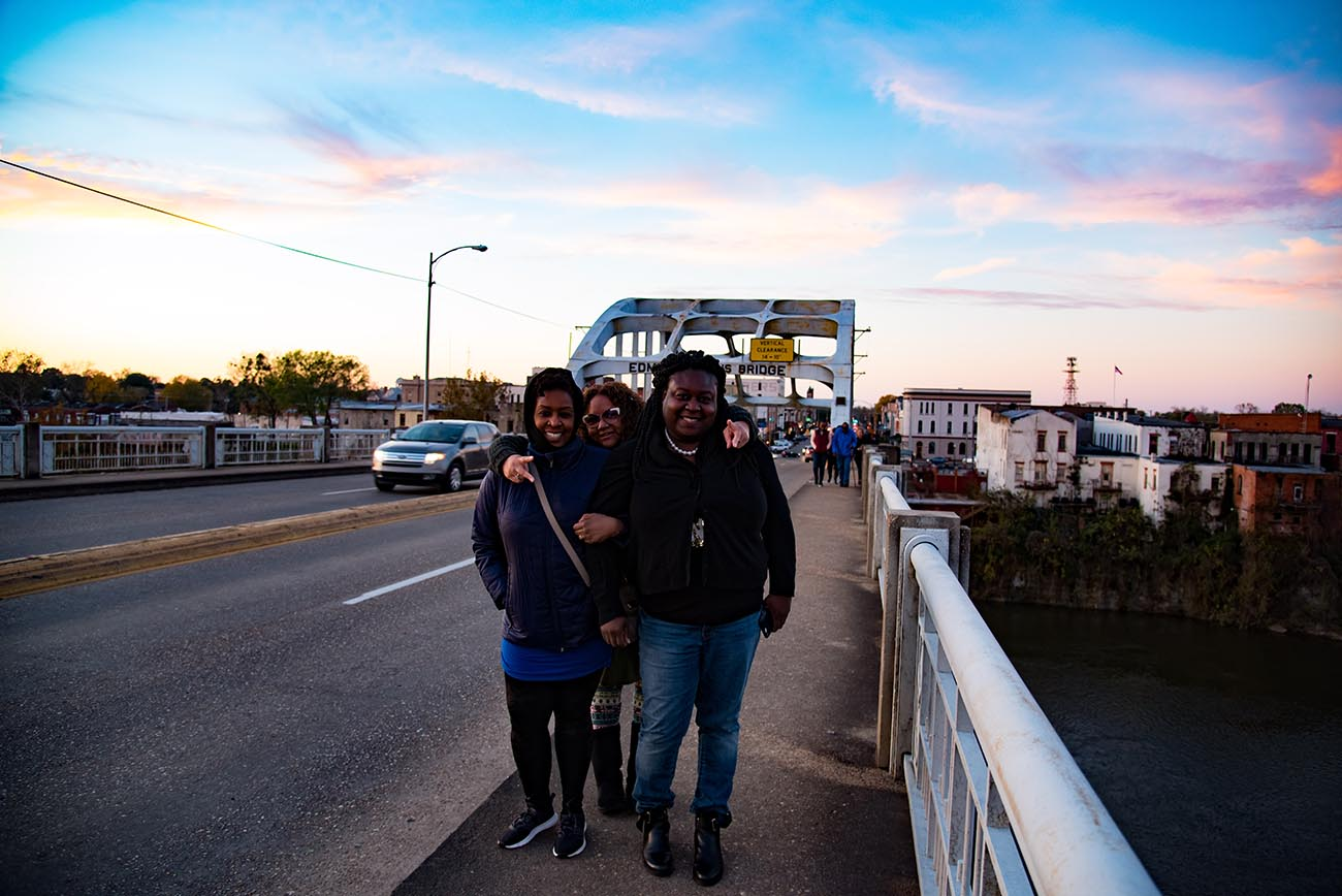 Image of AIR staff on the Edmund Pettis Bridge in Selma Alabama