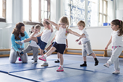 Image of preschoolers dancing on mats