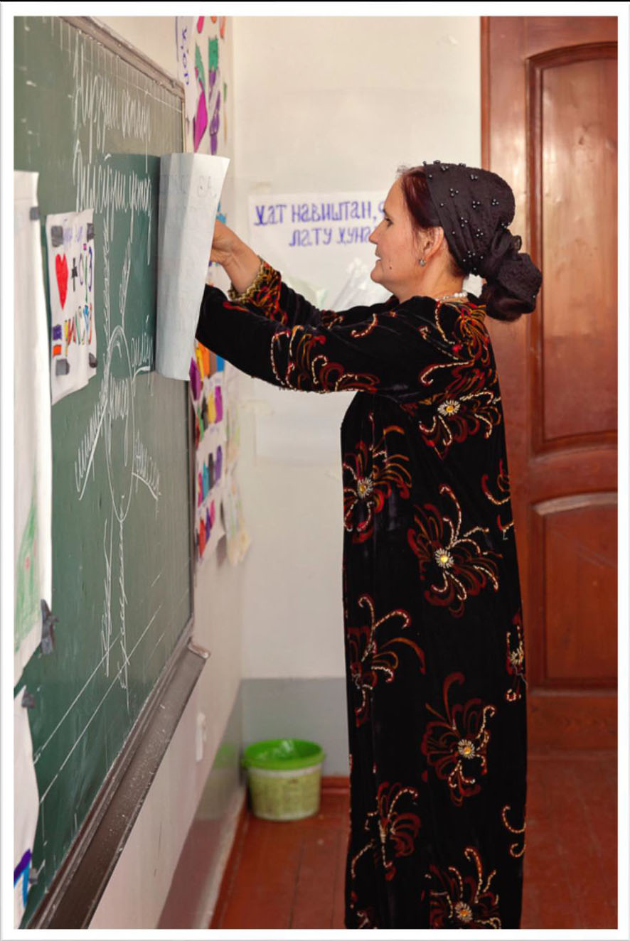 Tajik teacher at chalkboard