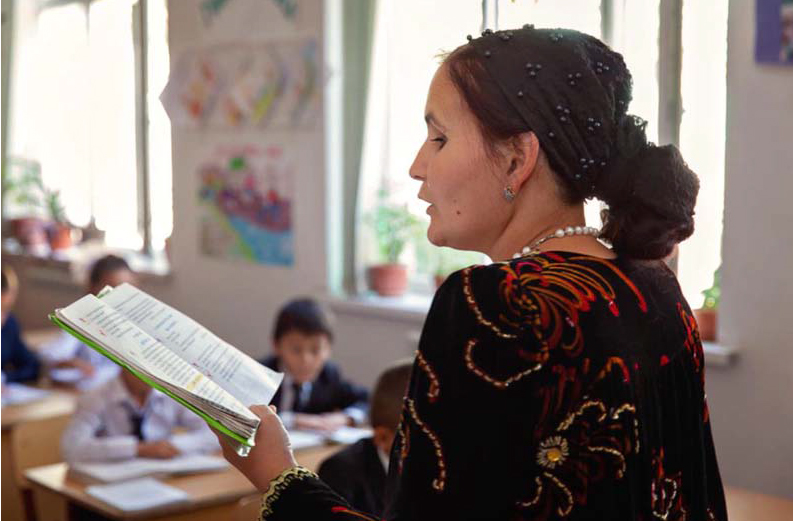 Tajik teacher reading to class