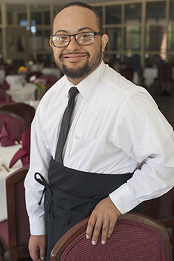 Image of young waiter with an intellectual disability