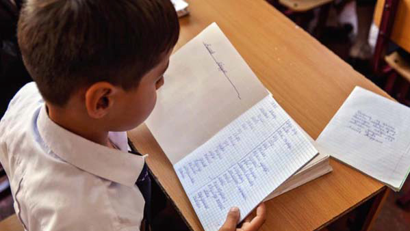 Tajik boy doing word study