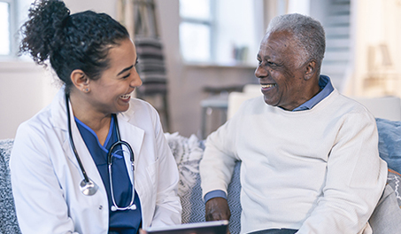 Image of doctor and patient laughing together