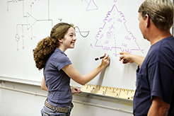 Female technical student at whiteboard