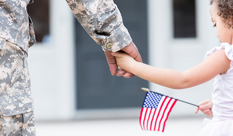Image of girl holding hands with a soldier, holding a flag