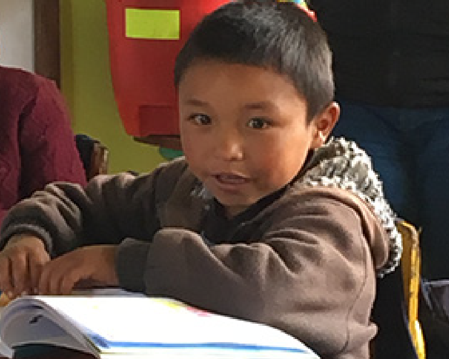 Image of boy in Guatemala classroom