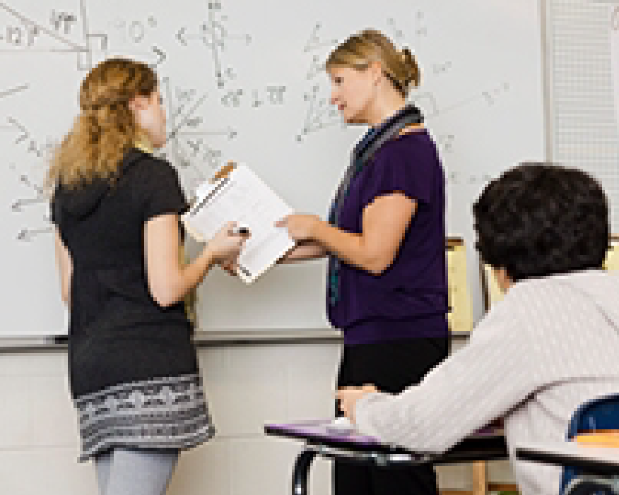 Image of teachers at whiteboard