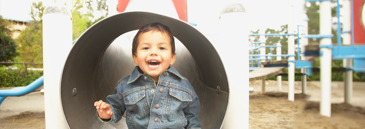 Native American boy playing in tunnel