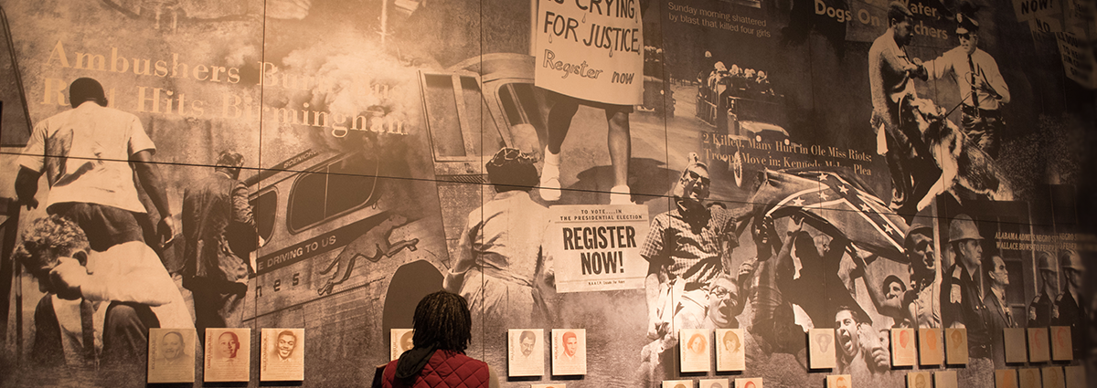 Image of woman looking at monument to civil rights