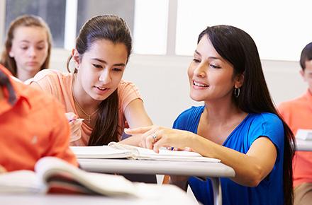 Image of Hispanic teacher and student