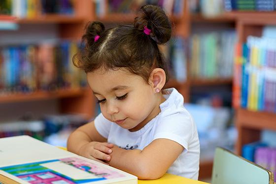 Image of preschool girl reading