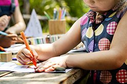 Image of girl drawing outside