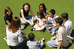 Kids in a circle with afterschool counselor