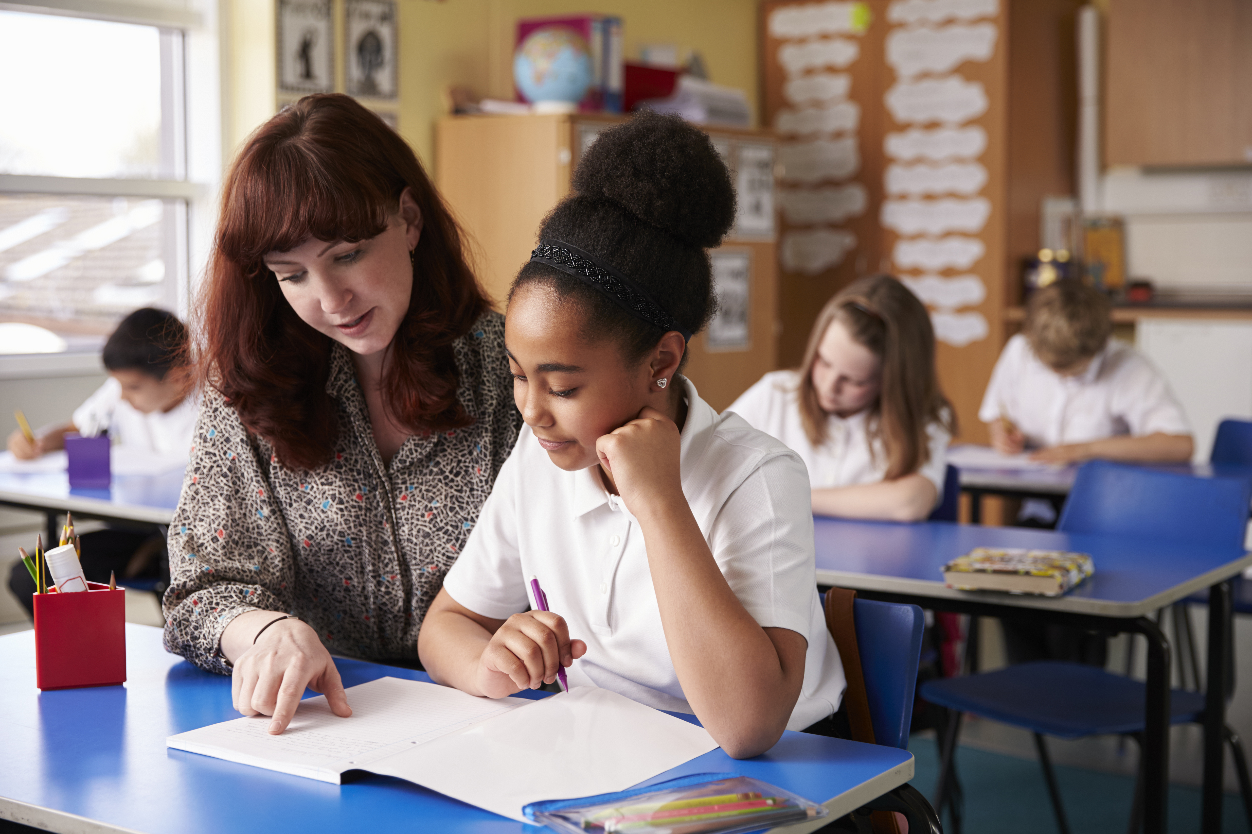 Teacher working closely with student
