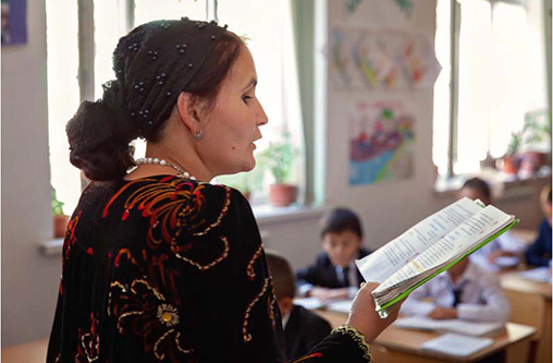 Image of Tajik teacher reading to class