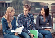 three college students in serious discussion