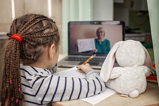 Image of young girl learning at her laptop