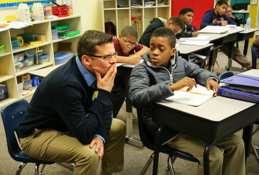 Kirk Walters works on math problem with student