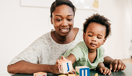 Image of mother and son playing with blocks