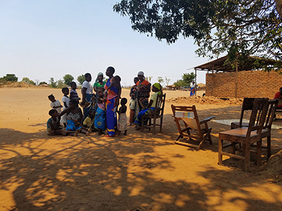 Image of mothers and young children outside in Mozambique
