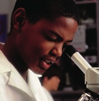 Student using a microscope