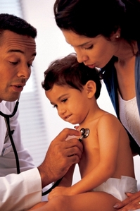 Doctor examining child with stethoscope