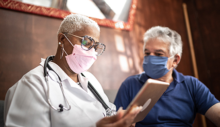 Image of older doctor speaking with patient