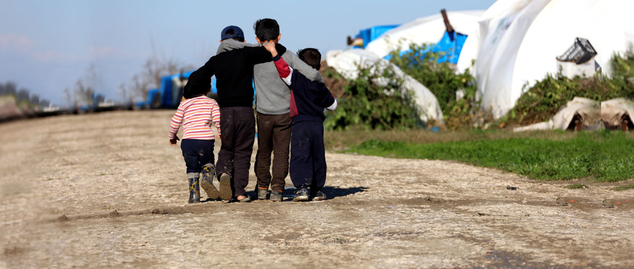 Image of children walking together in a refugee camp