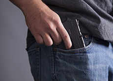 Man with gun in pocket