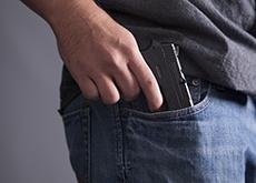 Man with gun in pocket