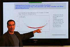 Man showing statistics on projector screen