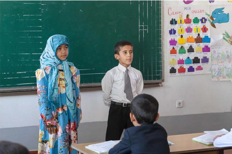 Tajik students at chalkboard