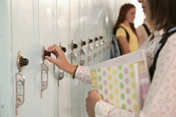 Bullied girl at locker