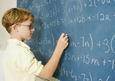 Boy doing math at chalkboard