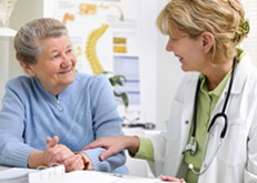 Doctor counsels older patient