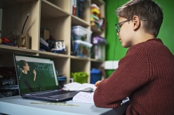 Image of boy distance learning on his laptop