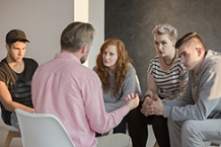 Image of addiction counselor and patients
