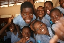 young Haitian students laughing
