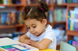 Image of preschool girl reading