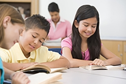 Image of boy and girl reading in classroom