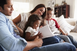 Image of Hispanic family reading together at home