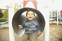 Image of smiling young Native American boy in tunnel