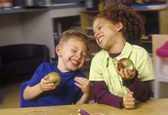 Preschool kids eating apples