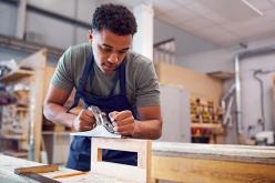 Image of apprentice using a sander