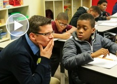 Math teacher working with student