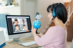 Teacher teaching virtually to students