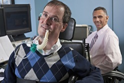 two workers with disabilities at computers